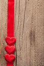 Red hearts and ribbon frame wooden background for valentines heart Stock Image