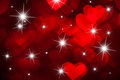 Red hearts shape with sparkles as background a Royalty Free Stock Image