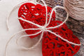 Red hearts tied with a rope near a skein of thread Royalty Free Stock Photo