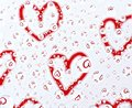 Red hearts in water drops Royalty Free Stock Photos