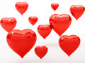 Red hearts on white background Stock Photos