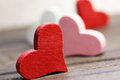 Red hearts on wooden table Royalty Free Stock Image