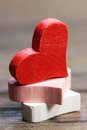 Red hearts on wooden table Stock Photography