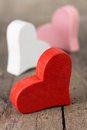 Red hearts on wooden table Stock Image