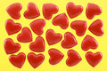 Red hearts on a yellow background Royalty Free Stock Image