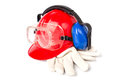 Red helmet with leather gloves and earmuffs eyes isolated Royalty Free Stock Image