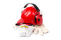 Red helmet with leather gloves and earmuffs eyes isolated Royalty Free Stock Images