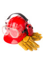 Red helmet with leather gloves and earmuffs tool isolated Stock Photos