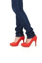 Red high heel shoes and jeans Royalty Free Stock Photos