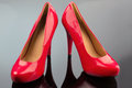 Red high heels photo icon for fashion elegance and eroticism Stock Images