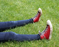 Red High Top Tennis Shoes in Green Grass Stock Photography