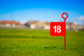 Red 18 hole golf flag Royalty Free Stock Photo