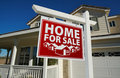 Red Home For Sale Real Estate Sign and House Royalty Free Stock Photo