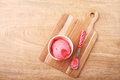 Red homemade strawberry ice cream scoop with spoon Royalty Free Stock Photo