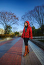 Red hood a woman wearing jacket and brown leather boots Royalty Free Stock Photography