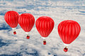 Red hot air balloons flying above cloudy sky Royalty Free Stock Photo