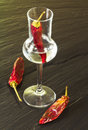 Red hot chili pepper grappa glass Stock Photo