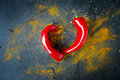 Red hot chili peppers in the shape of heart on wooden background Royalty Free Stock Images