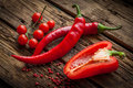 Red hot chili peppers, sweet pepper on wooden table Royalty Free Stock Photo