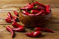 Red hot chilli pepper in wooden bowl Royalty Free Stock Photo
