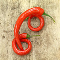 Red hot chillies chilli peppers on wood background Royalty Free Stock Image