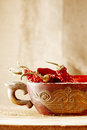 Red hot chillies pepper in old wooden bowl Stock Images