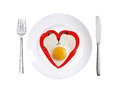 Red hot chilly peppers and fried egg on white plate isolated Royalty Free Stock Photo