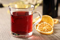 Red hot drink and orange sliced with Royalty Free Stock Photography