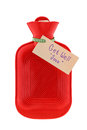 A red hot water bag with a paper written Get Well Soon Royalty Free Stock Photo