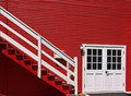 Red house exterior with white doors and stairs Stock Image