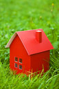 Red house pasteboard with a chimney of herbs Royalty Free Stock Images