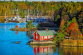 Red house on rocky shore of Ruissalo island, Finland Royalty Free Stock Photo
