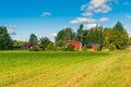 Red houses in a rural landscape Royalty Free Stock Photo