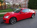 Red hyundai genesis coupe photo of in a washington dc neighborhood during spring this car comes with a standard v engine of hp and Stock Image