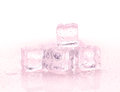 Red ice cubes on the white background Royalty Free Stock Photo