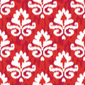 Red ikat damask seamless background pattern Royalty Free Stock Image