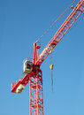 Red industrial construction crane above blue sky background Royalty Free Stock Photo