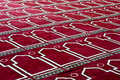 Red Islamic praying Carpet In pattern Royalty Free Stock Photo
