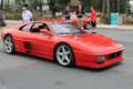 Red italian sports car front side view ferrari f in going down mountain road at event in virginia Stock Photography
