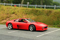 Red italian sports car front side view ferrari f in on mountain parking lot at event in virginia Stock Photos