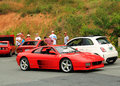Red italian sports car front side view ferrari f in among other cars on mountain parking lot at event in virginia Royalty Free Stock Photo