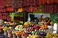 Red chili and tropical fruits for sale Royalty Free Stock Photo