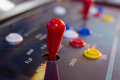 Red joystick with buttons on old arcade Royalty Free Stock Photo