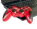 Red joystick game controller on laptop .