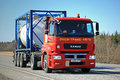 Red Kamaz Truck T1840 Tank Container Transport on Sunny Day Royalty Free Stock Photo