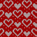 Red knitted background with hearts. Royalty Free Stock Photo