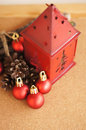 Red lantern and christmas balls with branches cones on brown background Stock Photo
