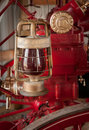 Red lantern hangs on fire engine gritty with dust Royalty Free Stock Image