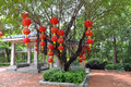 Red lantern a lush dense trees hanging lanterns jubilant square park chinese traditional culture spherical green retro Stock Image