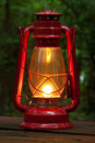 Red Lantern on Picnic Table Stock Photography